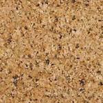 Hienorakeinen ja monivärinen graniitti. Yleisvaikutelma on vaalean ruskea ja suuntautumaton. Kivessä on mustia pieniä pilkkuja ja vaaleita läiskiä vaalean ruskeiden kiteiden seassa. Valmiit tasot on suojakäsiteltävä ennen käyttöönottoa. Louhintapaikka Intia.