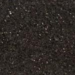 Musta graniitti, jossa esiintyy pieniä pronssin tai kullan värisiä välkehtiviä kiteitä. Välkehtiviä kiteitä voi esiintyä myös suonina tai suurempina alueina. Yleisvaikutelma on kimalteleva musta. Louhintapaikka Intia.
