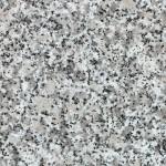 Valkomustaharmaa ja vaalea graniitti. Keskirakeinen koostumus. Satunnaisesti pieniä mustia läiskiä ja 30-50 mm kokoisia pallokuvioita. Valmiit tasot on suojakäsiteltävä ennen käyttöönottoa. Louhintapaikka Italia.