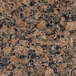 Isorakeinen ja pallokuvioinen graniitti. Yleisvaikutelma ruskea. Ruskean sävy vaihtelee louhimoittain. Satunnaisesti suuria 50-70 mm kokoisia pallokuvioita. Ominaispiirteenä on mustia ja monivärisiä pieniä läiskiä. Louhintapaikka Suomi.